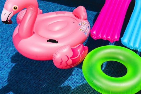 Working at Swiftcourt, Pool with floaties, Image cred Toni Cuenca via Unsplash